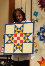 Sharon Barnes with her Barn Quilt Sign