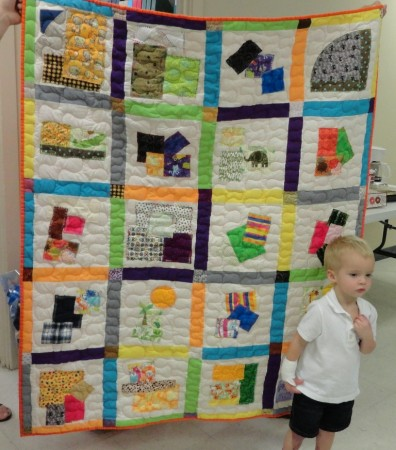 Kolton with raffle quilt