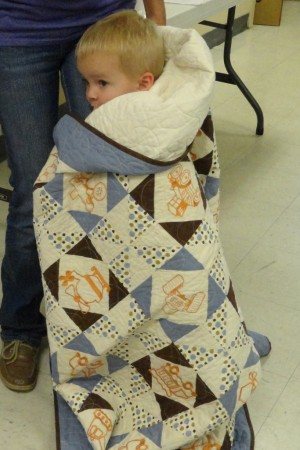 Kolton wrapped up in his quilt