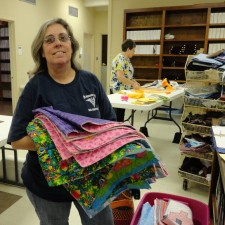 Doris bringing in quilts