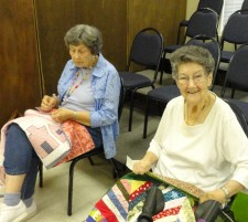 Elaine and Lois adding bindings