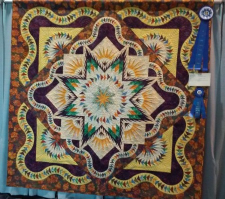 """Mad Dash"" by Leslie Kiger, quilted by Lori Millsap"
